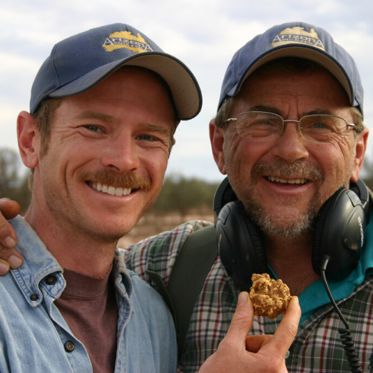 Father & Son Smiling With Gold Nugget